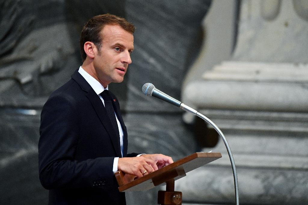 "Macron said he was ""truly moved"" to be made an honorary canon of St John Lateran, the cathedral of Rome (AFP Photo/Alberto PIZZOLI)"