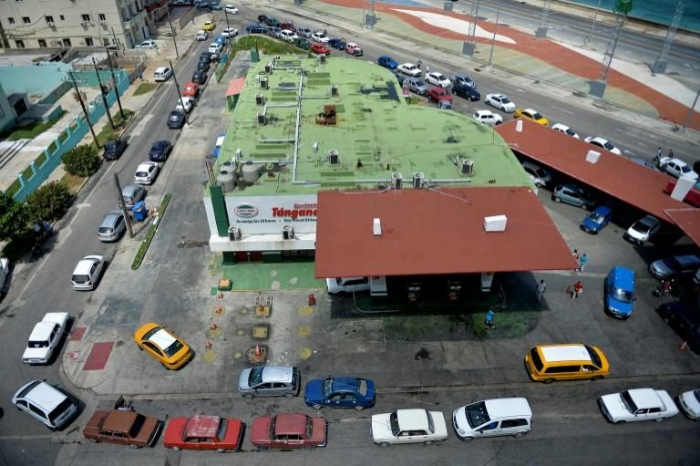 Give us gasoline! Drivers line up to get their tanks filled at a Havana fuel station