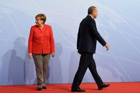 FILE PHOTO: German Chancellor Angela Merkel greets Turkey's President Recep Tayyip Erdogan at the beginning of the G20 summit in Hamburg, Germany, July 7, 2017. REUTERS/Bernd Von Jutrczenka/POOL/File Photo