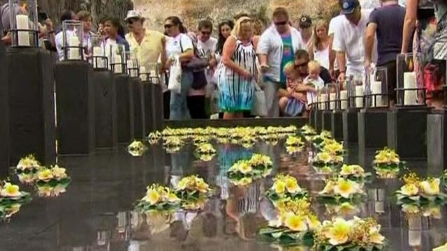 Tears, threats 10 years after Bali bombings