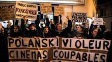 Roman Polanski leaves movie premiere in Paris by side door following protests