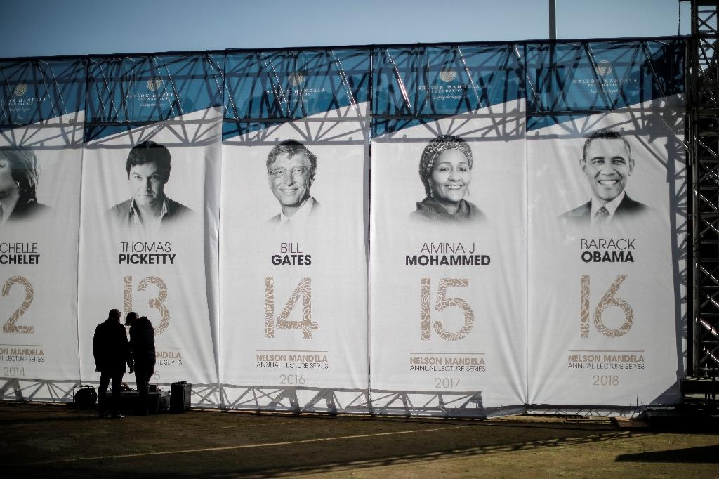 Banners depicting former US president Barack Obama, right, and other speakers who have given the Nelson Mandela Annual Lecture (AFP Photo/MARCO LONGARI)
