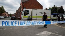 UK lowers attack threat level as police close in on bomber's network