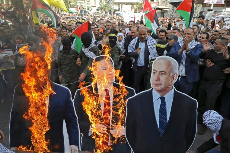 Palestinian protesters burned cardboard cutouts of US President Donald Trump, his State Secretary Mike Pompeo, and Israeli Prime Minister Benjamin Natanyahu, during a demonstration in Nablus city in the occupied West Bank on Tuesday