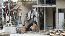 Rain pounds central Japan as 61 feared dead in south