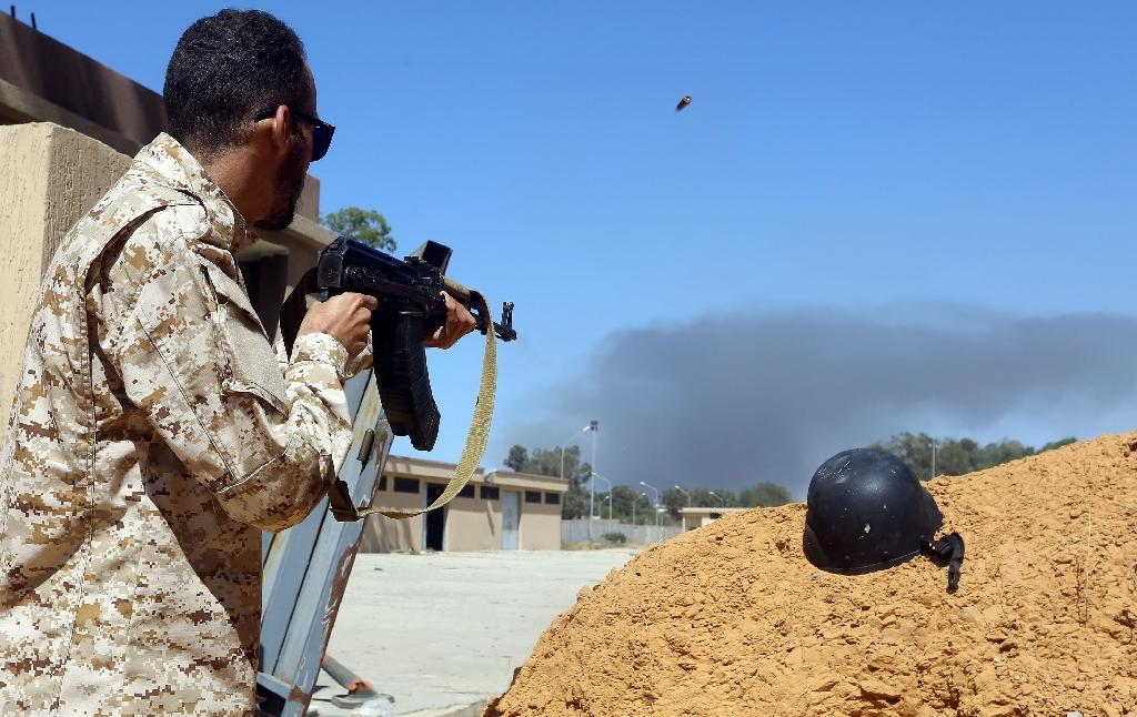 A fighter loyal to the internationally recognised government in Tripoli holds a position south of the capital as forces under commander Khalifa Haftar set their sights on taking the capital