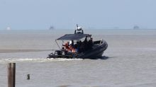 Rescuers find two of 14 missing crewmen of capsized vessel