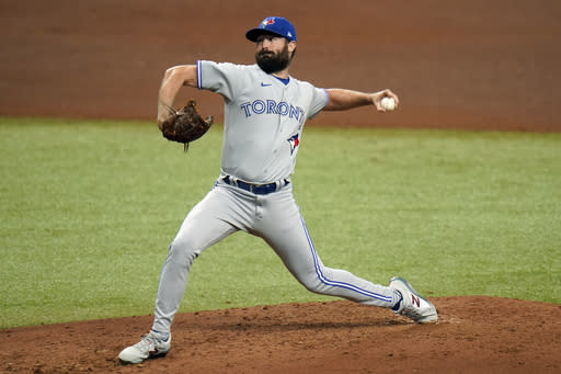 Toronto Blue Jays' Robbie Ray pitches to the Tampa Bay Rays during the fourth inning of Game 1 of a wild card series playoff baseball game Tuesday, Sept. 29, 2020, in St. Petersburg, Fla. (AP Photo/Chris O'Meara)