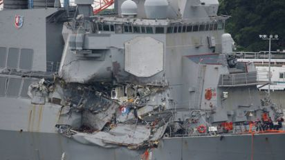 U.S. Navy, citing poor seamanship, removes commanders of warship in deadly crash