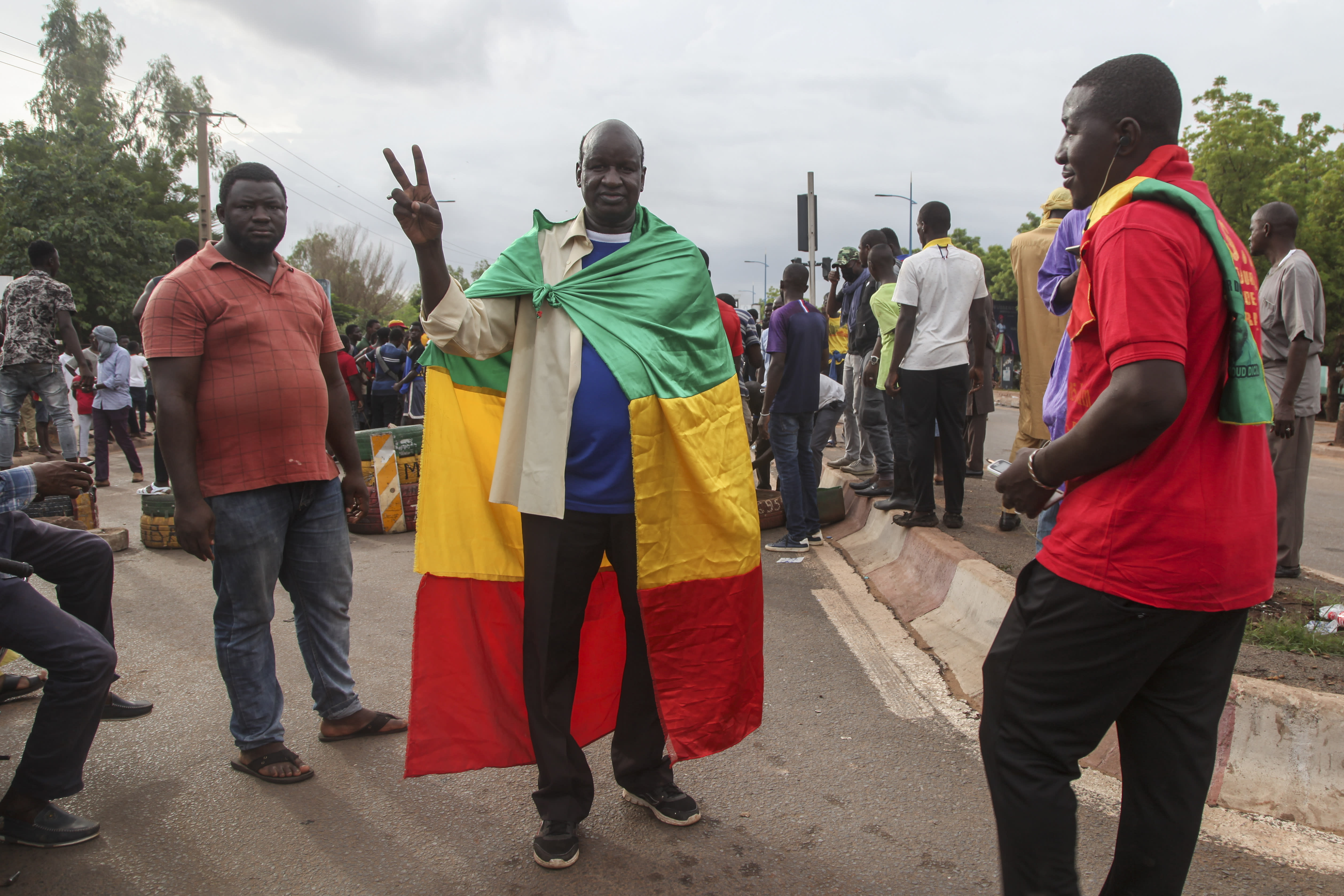 Anti-government protesters demonstrate in the capital Bamako, Mali Friday, July 10, 2020. Thousands marched Friday in Mali's capital in anti-government demonstrations urged by an opposition group that rejects the president's promises of reforms. (AP Photo/Baba Ahmed)