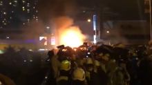 Petrol Bombs Rain Down on Police Van as it Approaches Protesters