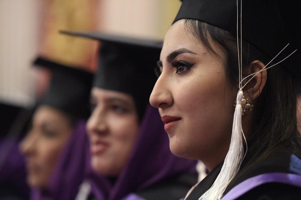 An Afghan female student looks on during the graduation ceremony of the first-ever class of Gender and Women's studies master's programme in Kabul