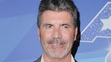 Simon Cowell 'rushed to hospital in an ambulance after falling down the stairs'