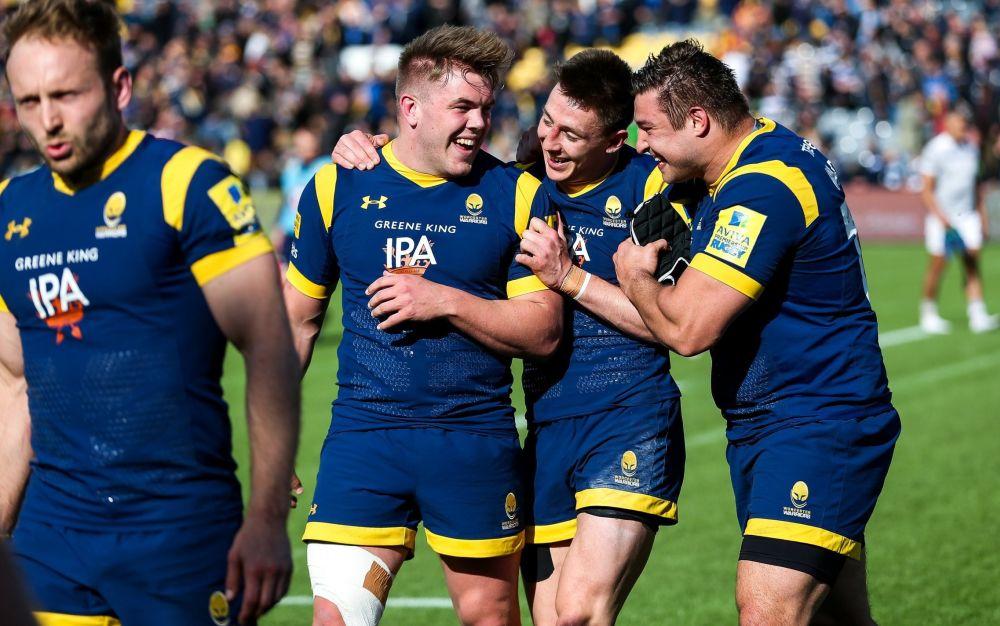 Jack Singleton, Josh Adams and Gareth Milasinovich celebrate after Worcester's win - Rex Features