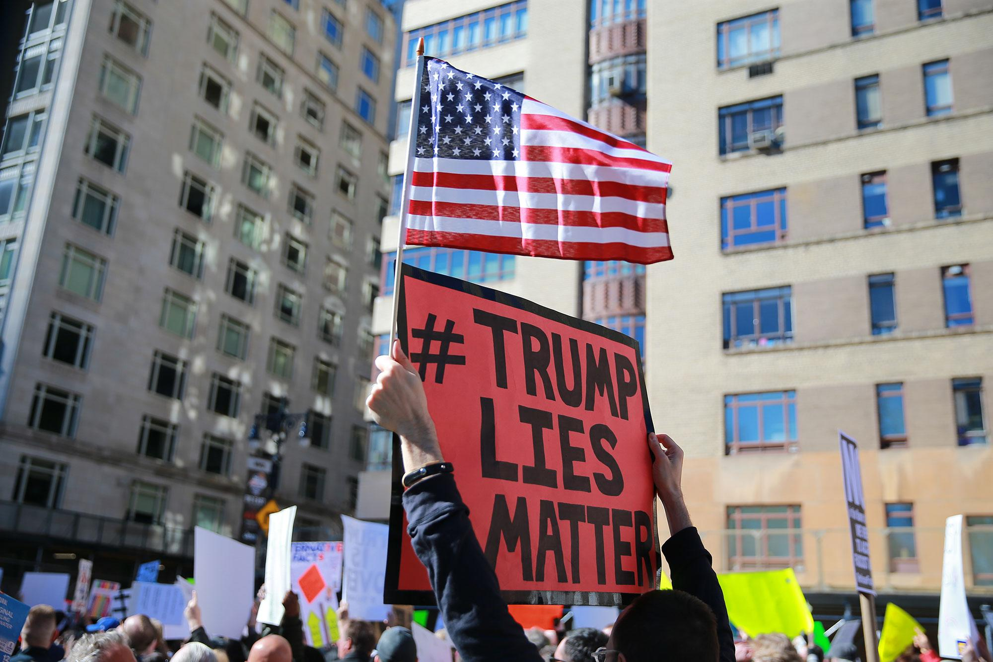 "<p>A demonstrator holds up a sign and U.S. flag during the ""Not My President's Day"" rally at Central Park West in New York City on Feb. 20, 2017. (Gordon Donovan/Yahoo News) </p>"