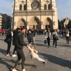 Woman searching for 'dad and daughter' in photo she took at Notre Dame moments before devastating fire