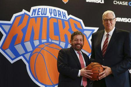 Jackson and New York Knicks owner Dolan pose during a news conference announcing Jackson as the team president of the New York Knicks basketball team at Madison Square Garden in New York