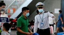 Vietnam curbs movement in city of 1.1m as virus-free run ends