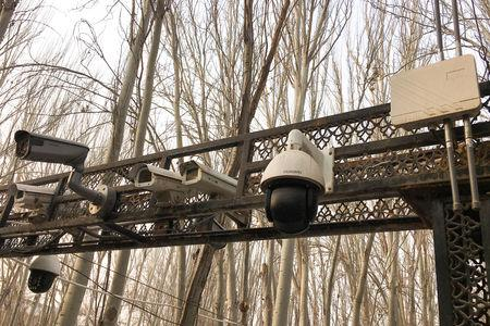 FILE PHOTO - Security cameras are installed at the entrance to the Id Kah Mosque during a government organised trip in Kashgar