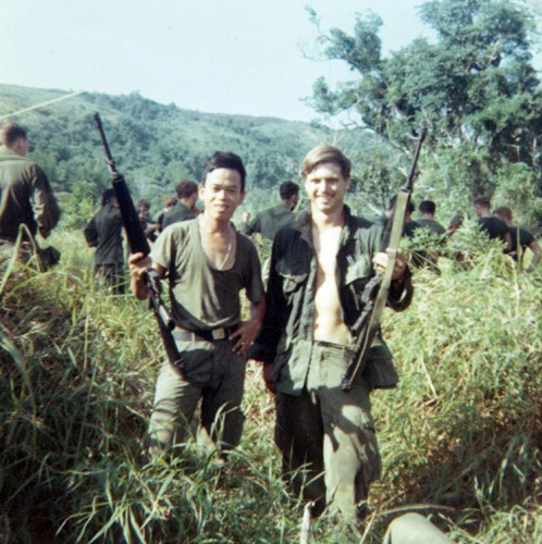 This 1969 photo provided by James McCloughan shows the former Army medic, right, with a platoon interpreter in Nui Yon Hill in Vietnam. McCloughan — who saved the lives of 10 soldiers during the Battle of Nui Yon Hill in May 1969 in Vietnam — will become the first person to be awarded the nation's highest military honor by President Trump. (Courtesy of James McCloughan via AP)