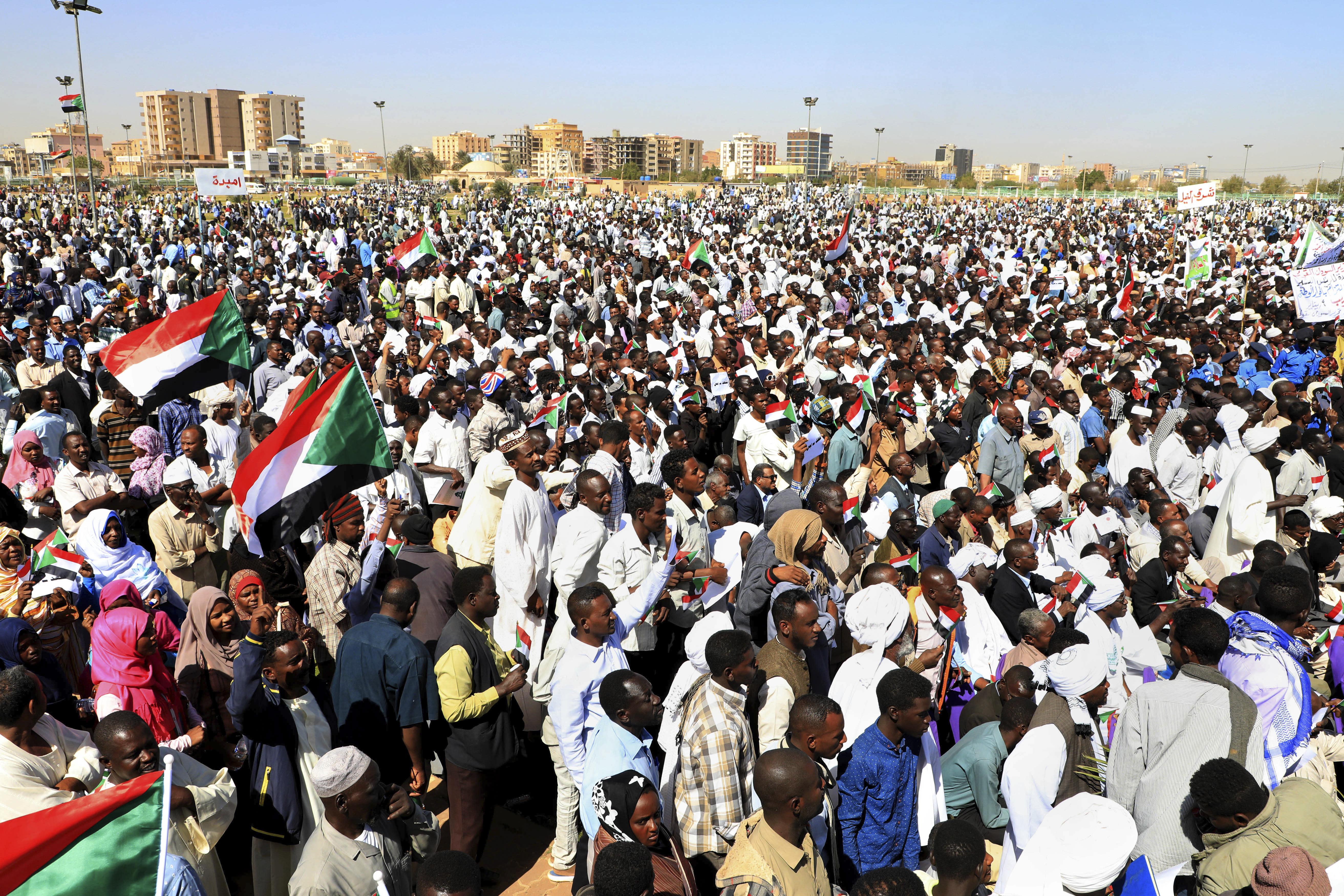 """Supporters of Sudan's President Omar al-Bashir attend a pro-government rally in Khartoum, Sudan, Wednesday, Jan. 9, 2019. Al-Bashir told the gathering of several thousands of supporters in the capital that he is ready to step down only """"through election."""" The remarks come after three weeks of anti-government protests. (AP Photo/Mahmoud Hjaj)"""