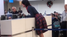 Woman calls JetBlue staff member a 'rapist' and threatens that she has a gun in viral video