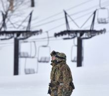 One killed as avalanche engulfs skiers after volcano erupts at Japanese resort