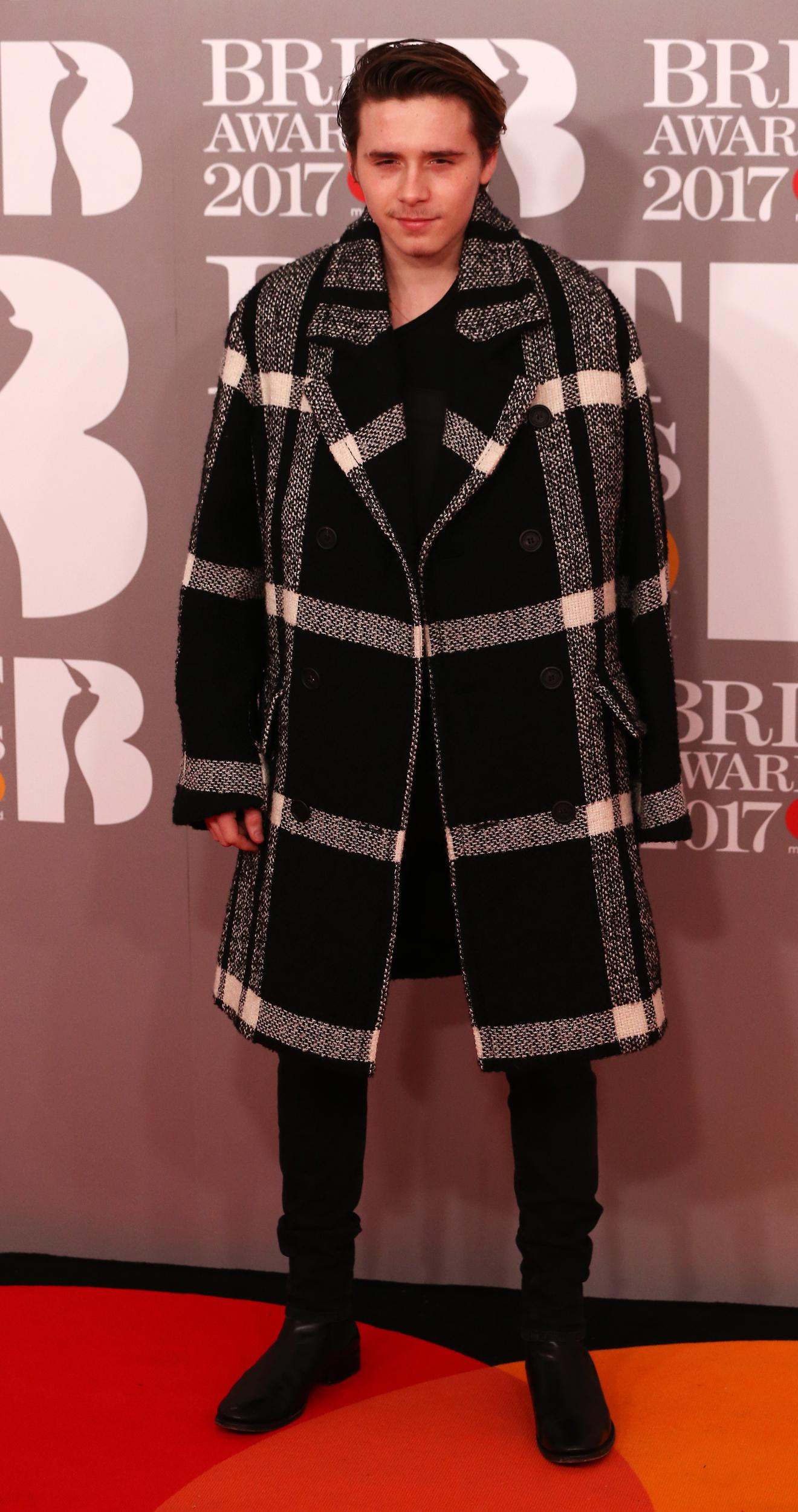 Brooklyn Beckham arrives for the Brit Awards at the O2 Arena in London, Britain, February 22, 2017.  REUTERS/Neil Hall EDITORIAL USE ONLY. FOR EDITORIAL USE ONLY. NOT FOR SALE FOR MARKETING OR ADVERTISING CAMPAIGNS
