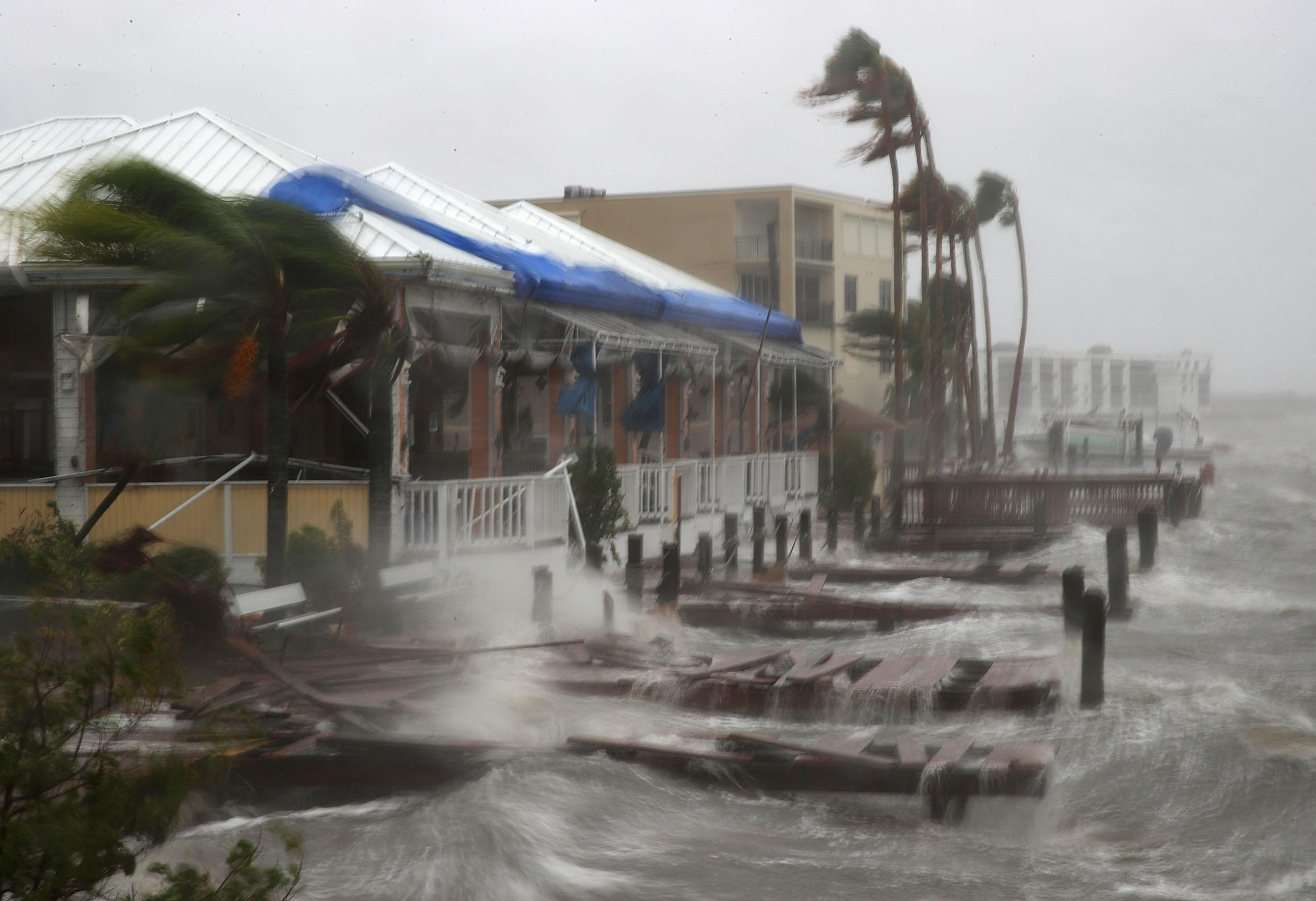 <p>Heavy waves caused by Hurricane Matthew pounds the boat docks at the Sunset Bar and Grill, Oct. 7, 2016 on Cocoa Beach, Fla. Hurricane Matthew passed by offshore as a catagory 3 hurricane bringing heavy winds and minor flooding. (Photo: Mark Wilson/Getty Images) </p>