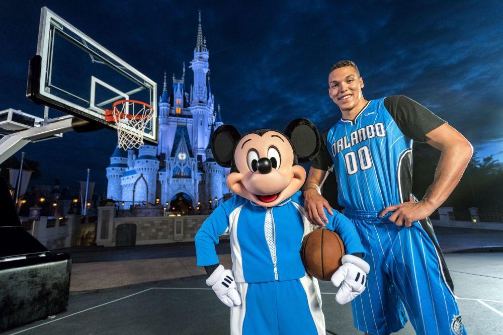 Aaron Gordon poses with an undersized forward in front of a castle. (Matt Stroshane/Walt Disney World)