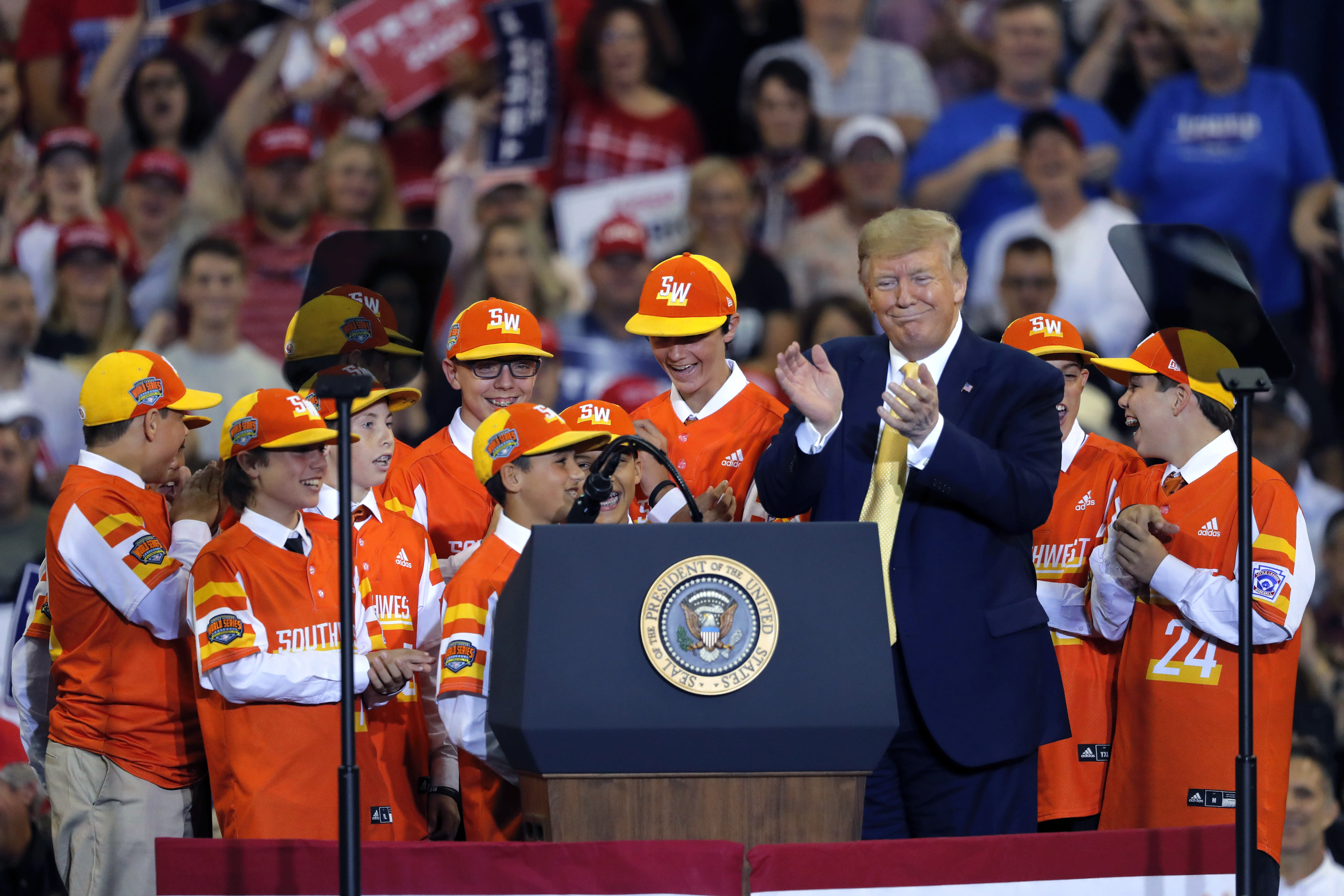 President Donald Trump introduces the reigning Little League World Series championship team from River Ridge, La., during his campaign rally in Lake Charles, La., Friday, Oct. 11, 2019. The team visited the White House earlier in the day, and the President flew them back to Louisiana on Air Force One. (AP Photo/Gerald Herbert)