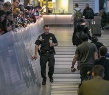 U.S. checks travelers as China confirms virus spreads between people