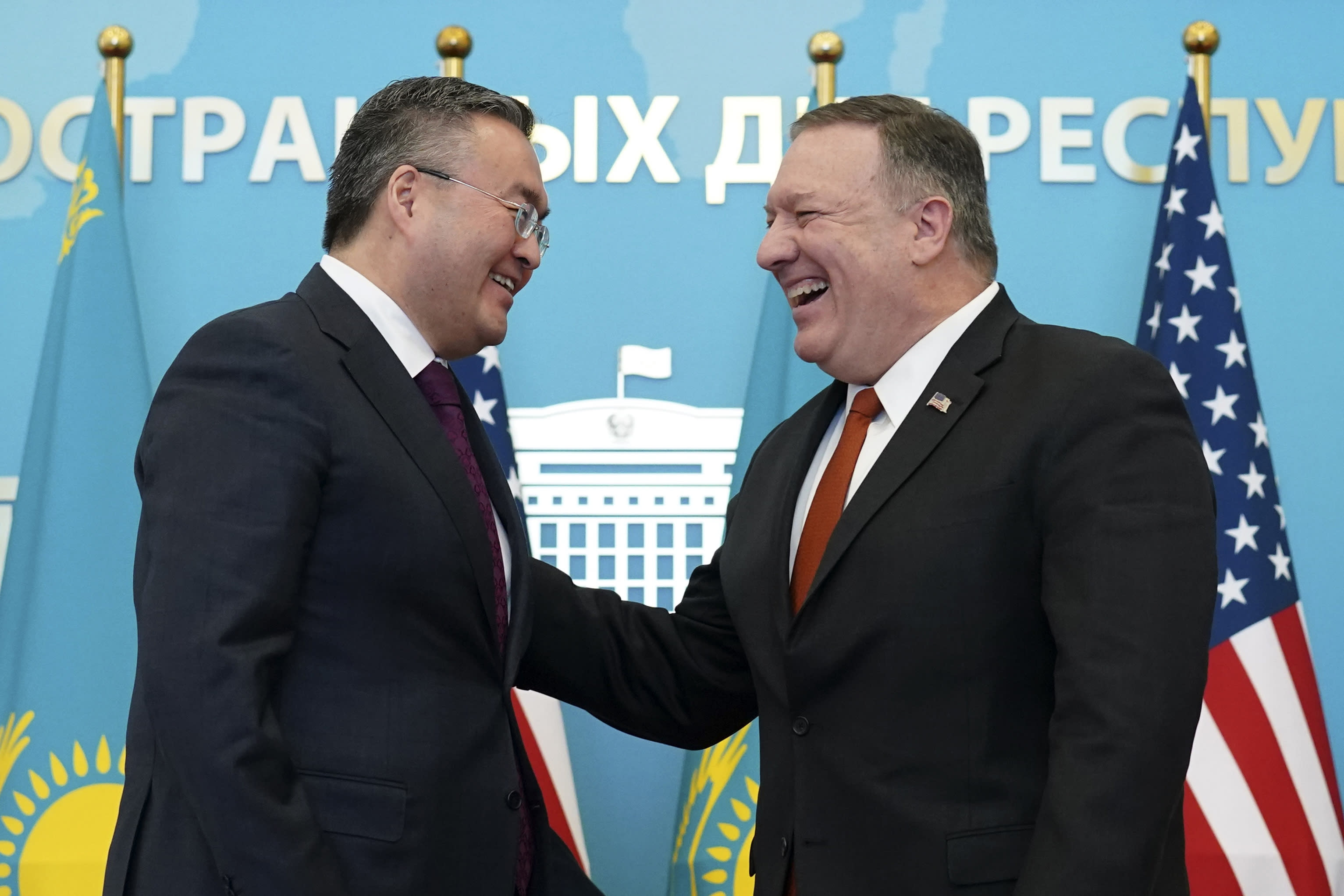 U.S. Secretary of State Mike Pompeo, right, reacts after holding a joint news conference with Kazakh Foreign Minister Mukhtar Tleuberdi at the Ministry of Foreign Affairs in Nur-Sultan, Kazakhstan, Sunday, Feb. 2, 2020. (Kevin Lamarque/Pool Photo via AP)