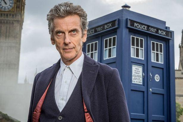 Peter Capaldi as the Doctor, with the TARDIS in the background