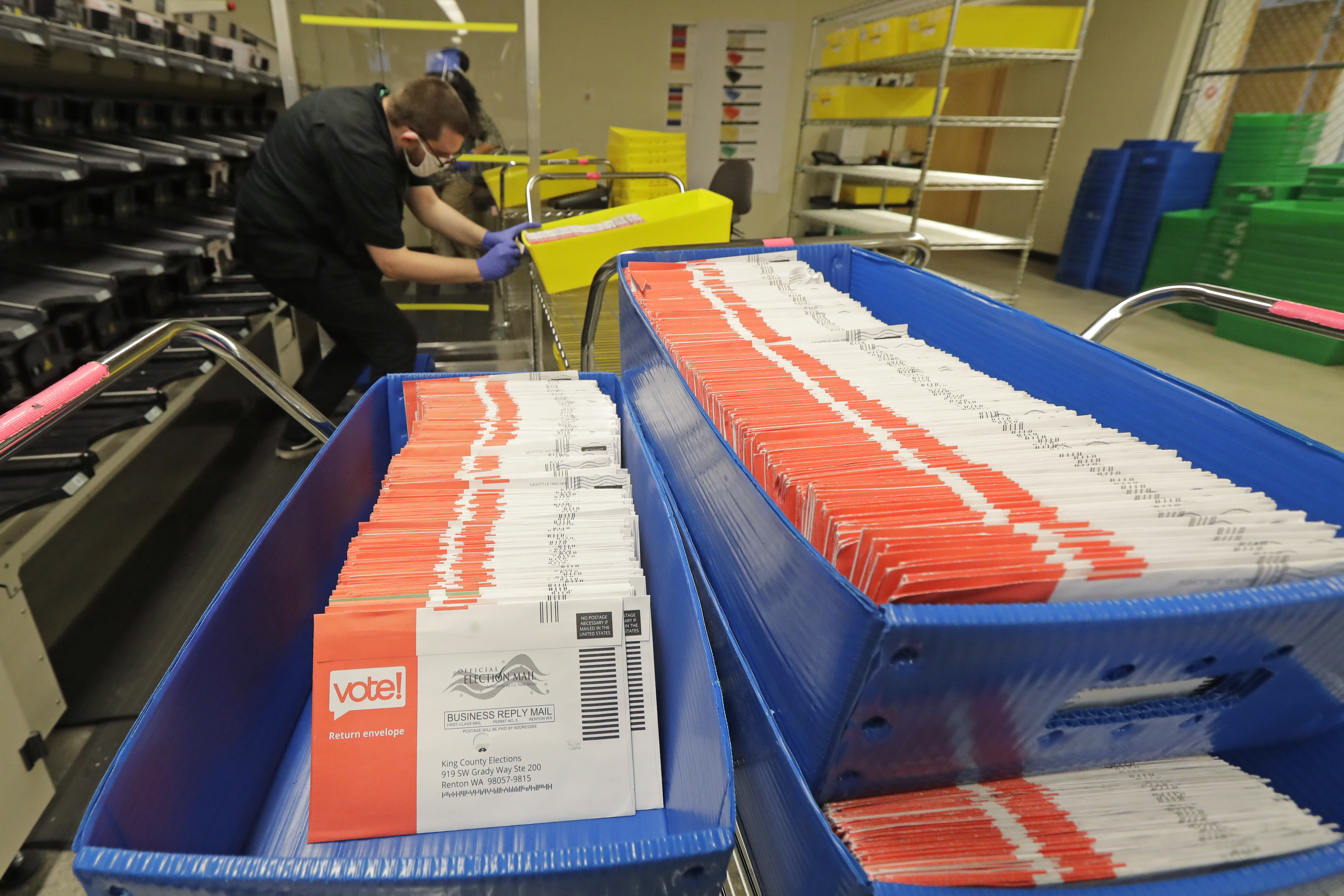 FILE - In this Aug. 5, 2020, file photo, vote-by-mail ballots are shown in sorting trays at the King County Elections headquarters in Renton, Wash., south of Seattle. In every U.S. presidential election, thousands of ballots are rejected and never counted. They may have arrived after Election Day or were missing a voter's signature. That number will be far higher this year as the coronavirus pandemic forces tens of millions of Americans to vote by mail for the first time. (AP Photo/Ted S. Warren, File)
