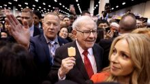Buffett defends Berkshire stock push, reassures on future as profit smashes record