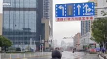 A teacher's videos inside quarantined Wuhan show the streets eerily deserted and lines out the door at the pharmacy