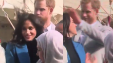 Prince Harry Was Caught on Camera Fixing Meghan Markle's Wind-Blown Hair