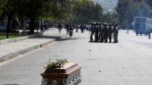 Haiti police fire rubber pellets at mourners as protests resume