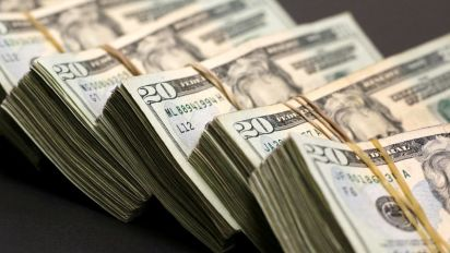 Dollar hits one-week high as focus shifts to Fed