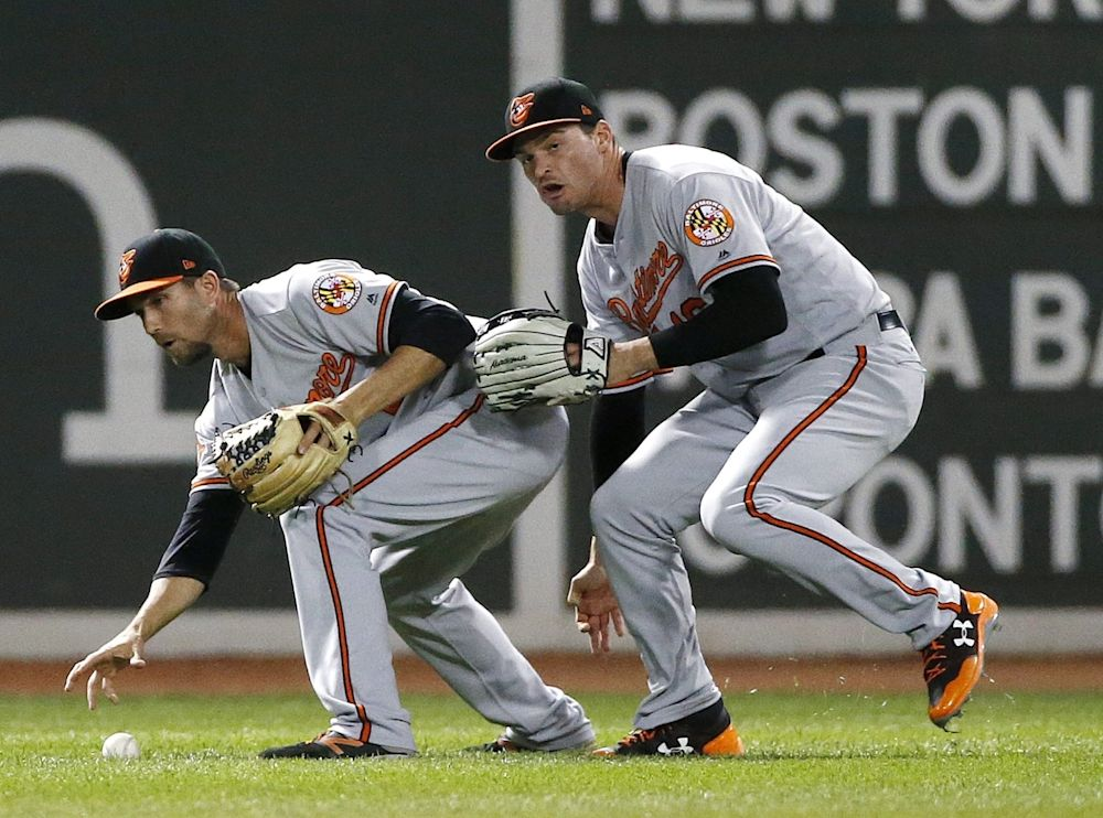 J.J. Hardy's failed catch turned into three easy outs for the Baltimore Orioles. (AP Photo/Michael Dwyer)