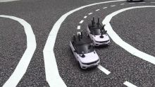 Driverless cars can work together to keep traffic moving, research finds