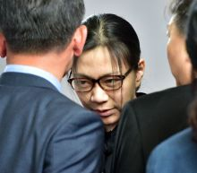 Korean Air boss apologises as hot-tempered daughters resign