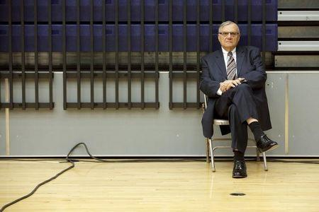 Maricopa County Sheriff Joe Arpaio listens to U.S. Republican presidential candidate Donald Trump speak at a campaign rally in Marshalltown