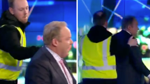 Peter Helliar escorted off The Project set