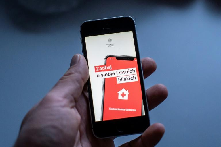 The Icon of a special aplication for people under coronavirus quarantine is seen on a smartphone in Warsaw, Poland (AFP Photo/Wojtek RADWANSKI)