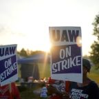 GM switches health insurance costs to union for striking workers; talks continue