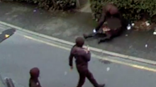 Shocking CCTV shows three men robbing a woman in her 70s in broad daylight