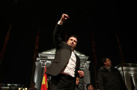 The leader of the opposition Social Democratic Union of Macedonia (SDSM) Zoran Zaev celebrates with supporters during parliamentary elections in Skopje, Macedonia, December 11, 2016. REUTERS/Stoyan Nenov