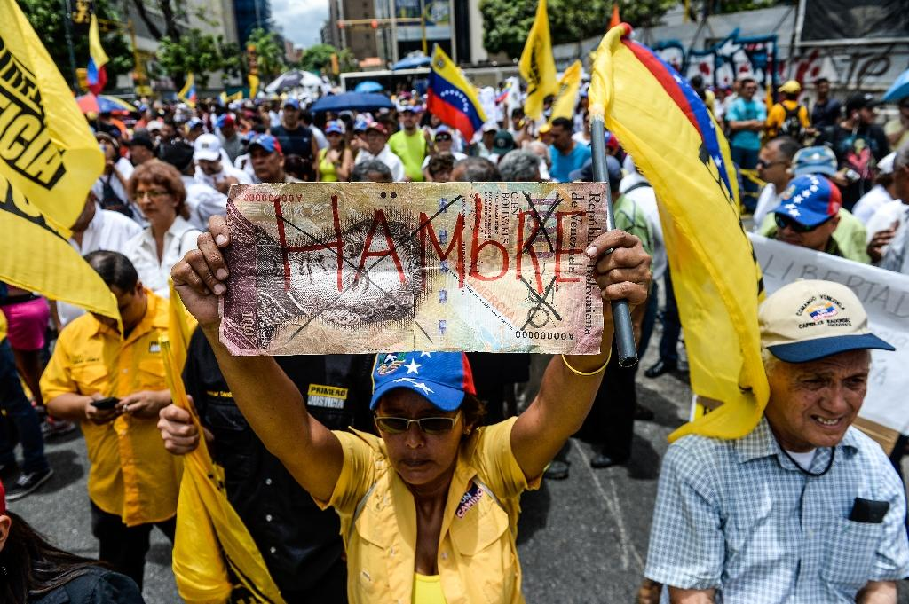 Venezuelans protest against crime and food shortages during a 2015 opposition rally in Caracas (AFP Photo/Federico Parra)